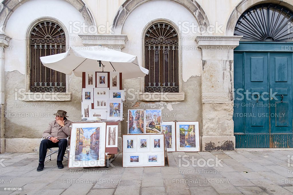 Artist waiting to sell his drawings stock photo