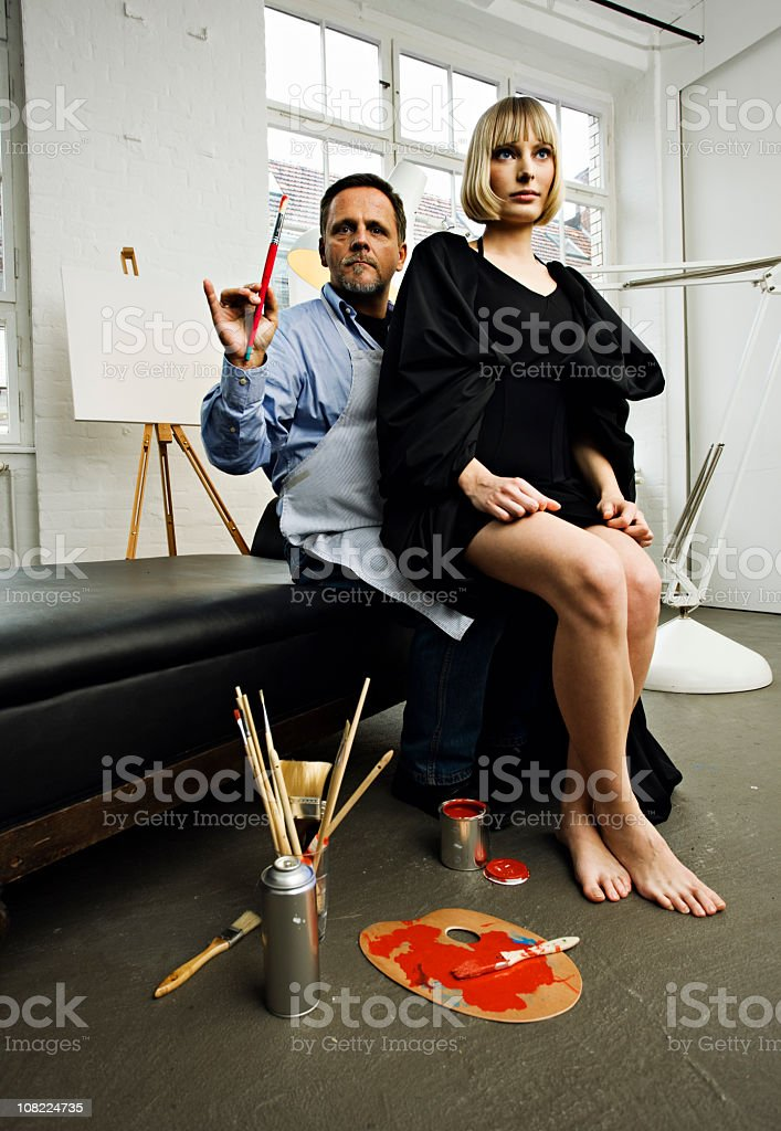 Artist with Model Perched on Knee royalty-free stock photo