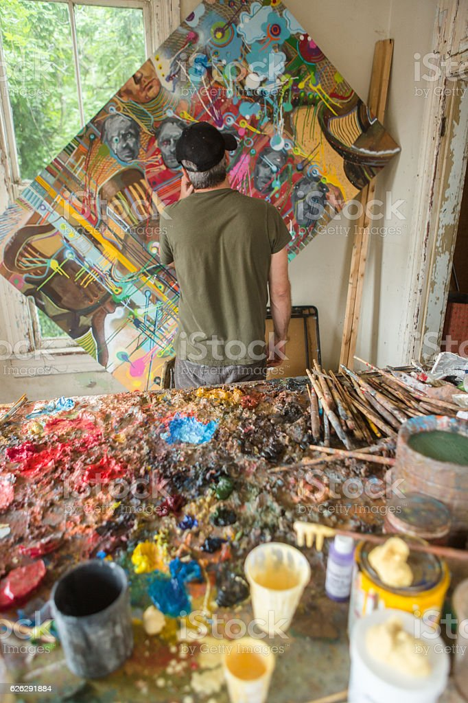 Artist working in studio stock photo
