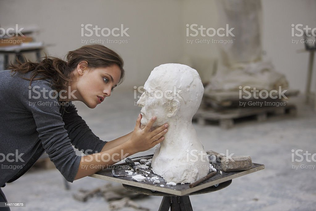 artist working on bust stock photo