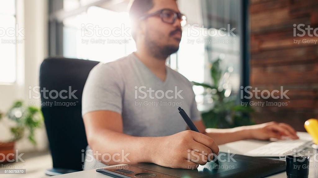 Artist working on digital graphic tablet using a stylus stock photo