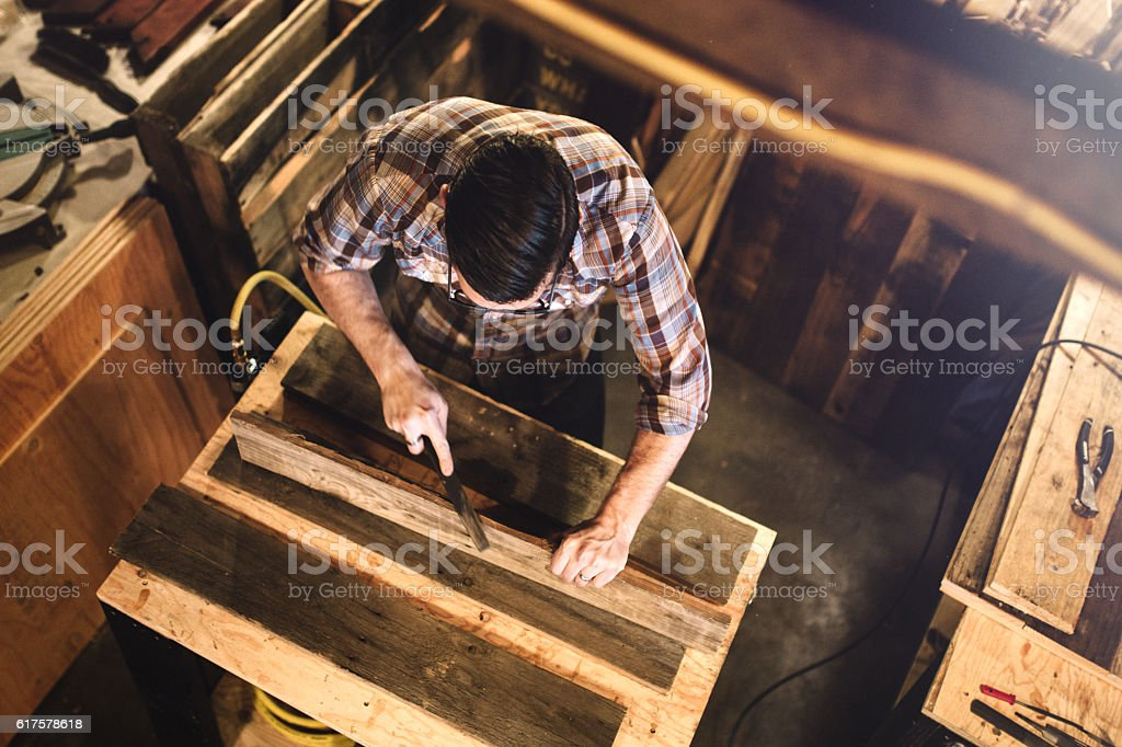 Artist Working With Wood in Studio stock photo
