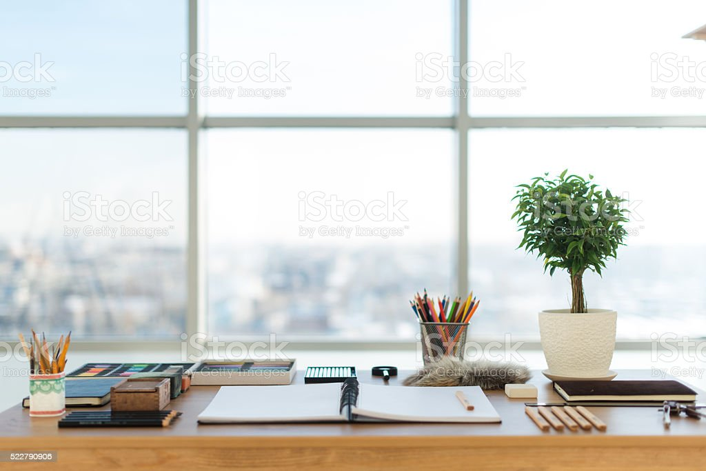 Artist workplace ready for pastel, drawing. Colorful pencils and crayons stock photo