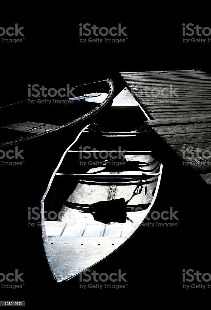 Artistic Black and White Metalic Canoes at Dock royalty-free stock photo