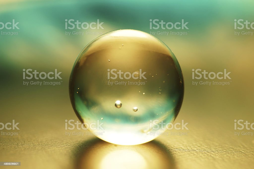 Artistic composition of aqua glass ball stock photo