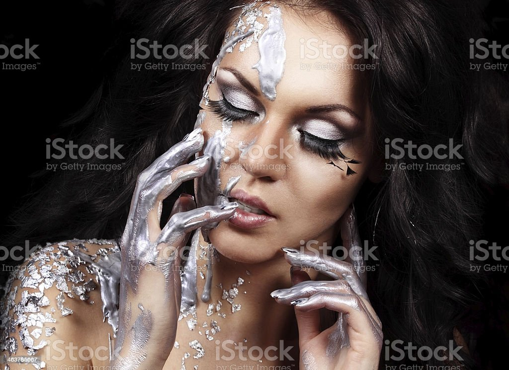 Artistic face with silver makeup and paint drops royalty-free stock photo