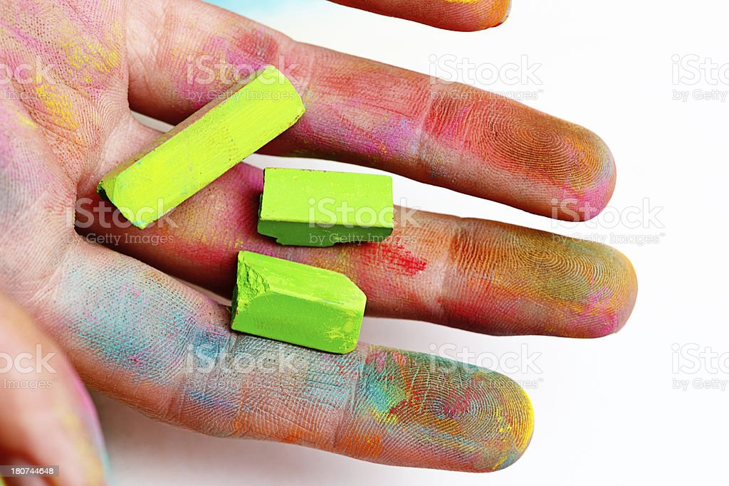 Artistic hand smudged by pastels: art can be messy! royalty-free stock photo