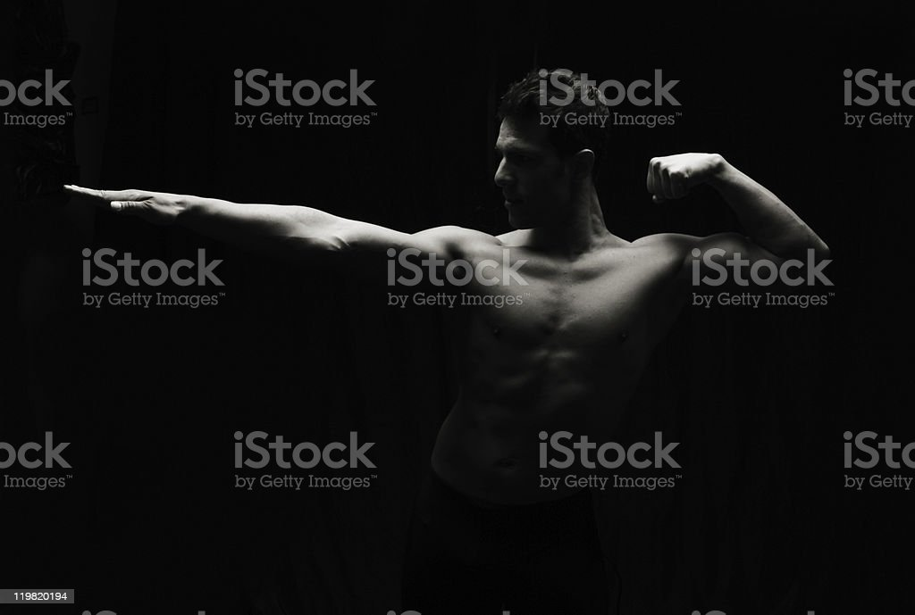 Artistic low key fitness man stock photo