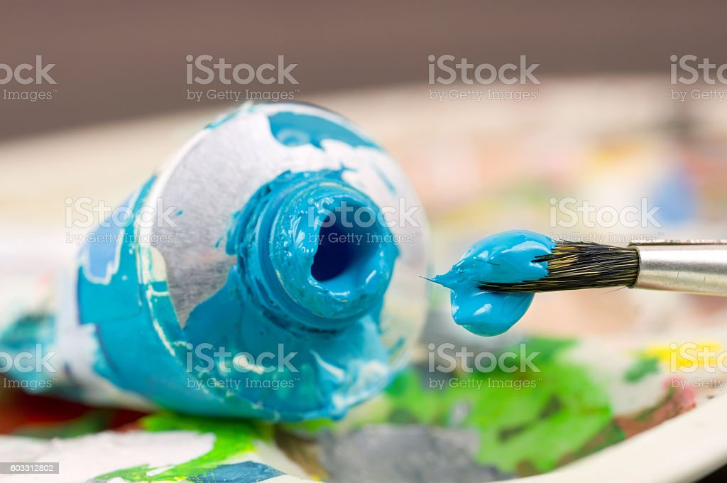 artistic paint brush with blue paint stock photo