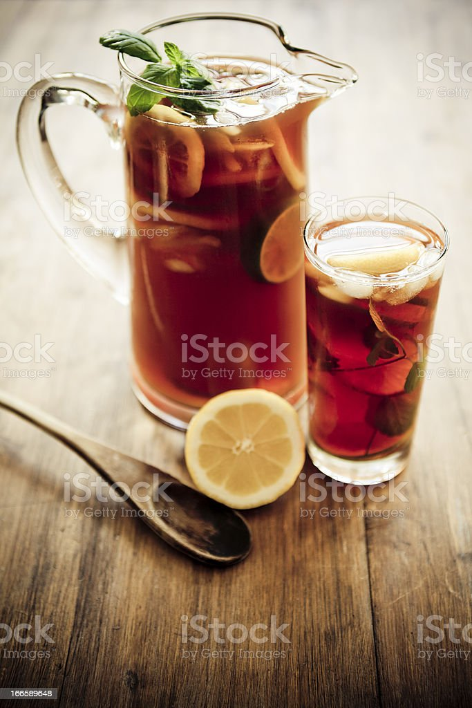 Artistic photo of a pitcher and glass of iced tea stock photo