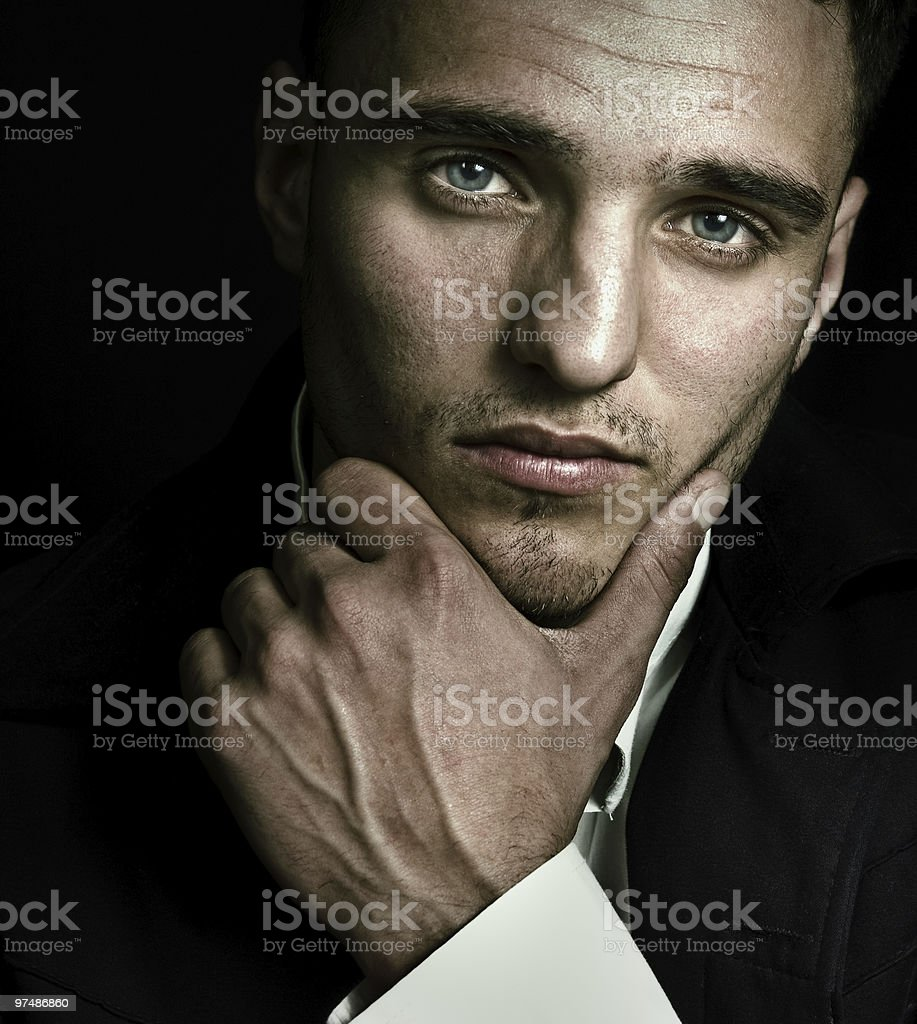 Artistic portrait of handsome man with blue eyes stock photo