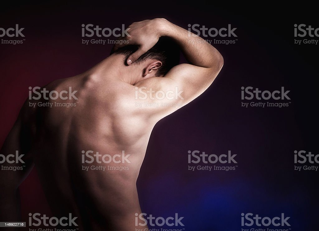 Artistic portrait of male from behind stock photo