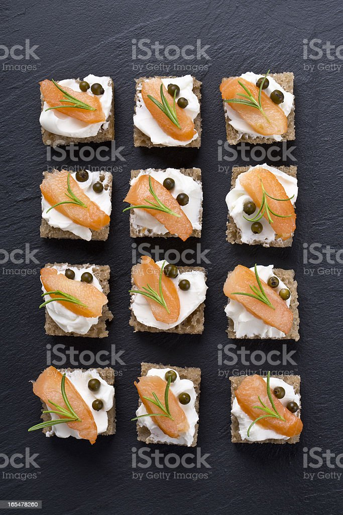 Artistic shot of carefully played salmon appetizers stock photo