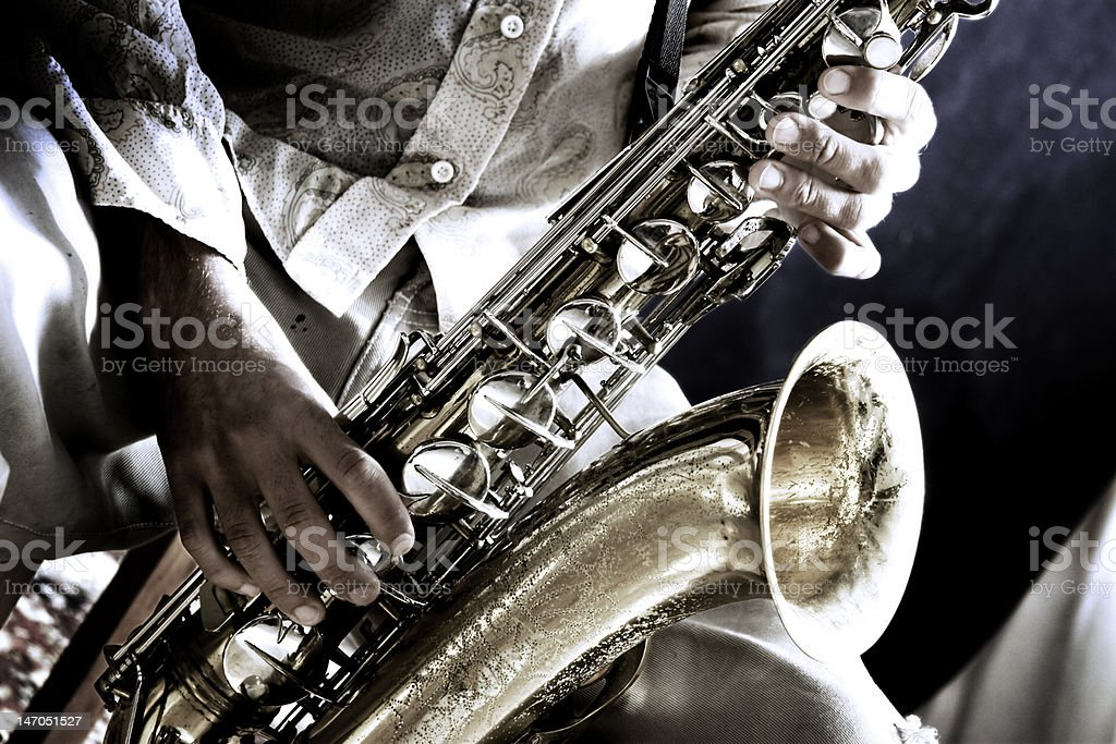 Artistic shot of man with saxophone stock photo