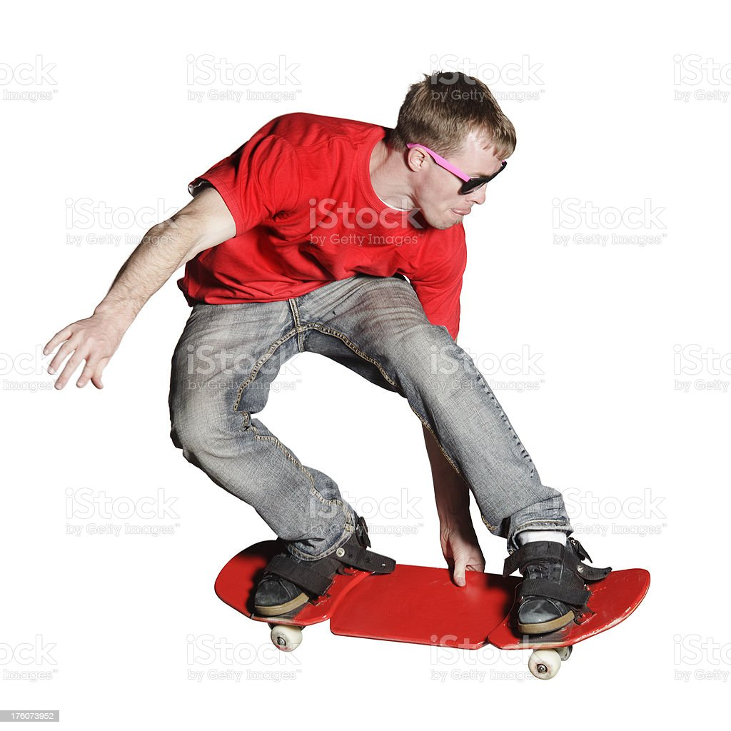 Artistic skateboarder caught mid-air, isolated  on white stock photo