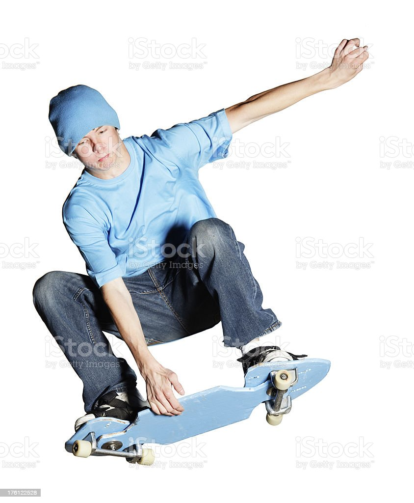 Artistic skateboarder caught mid-air, isolated  on white royalty-free stock photo