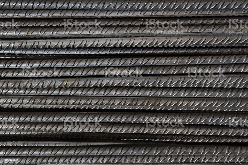 Artistic steel bars closeup, reinforcement on construction site, editable background. stock photo