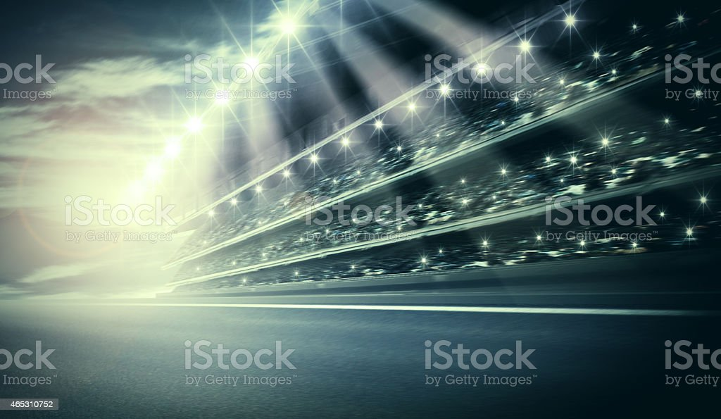 Artistic track arena with bright lights shining stock photo