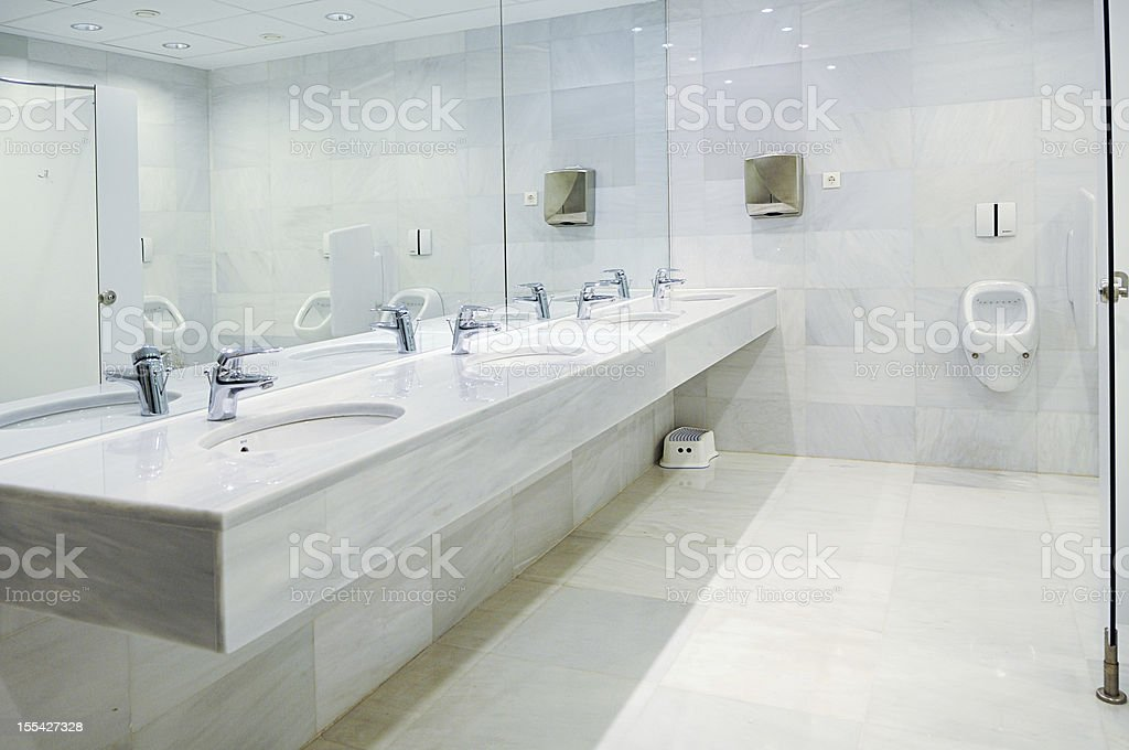 Artistic view of clean, marble, empty men's bathroom stock photo