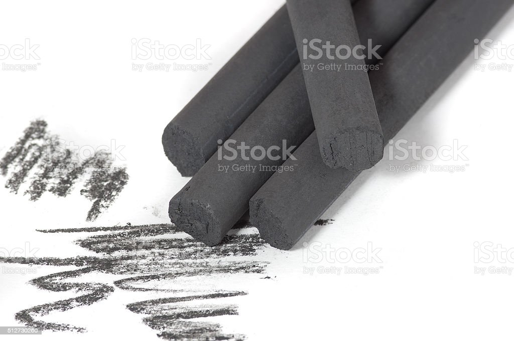 Artist's black charcoal stock photo