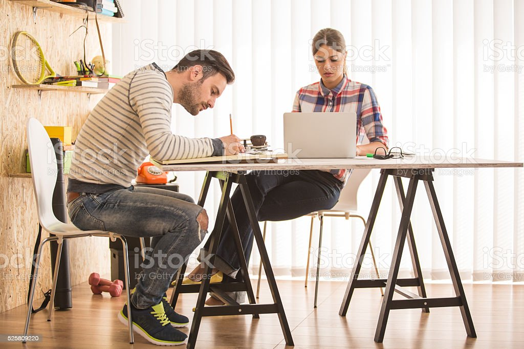 Artists drawing, working at modern office stock photo