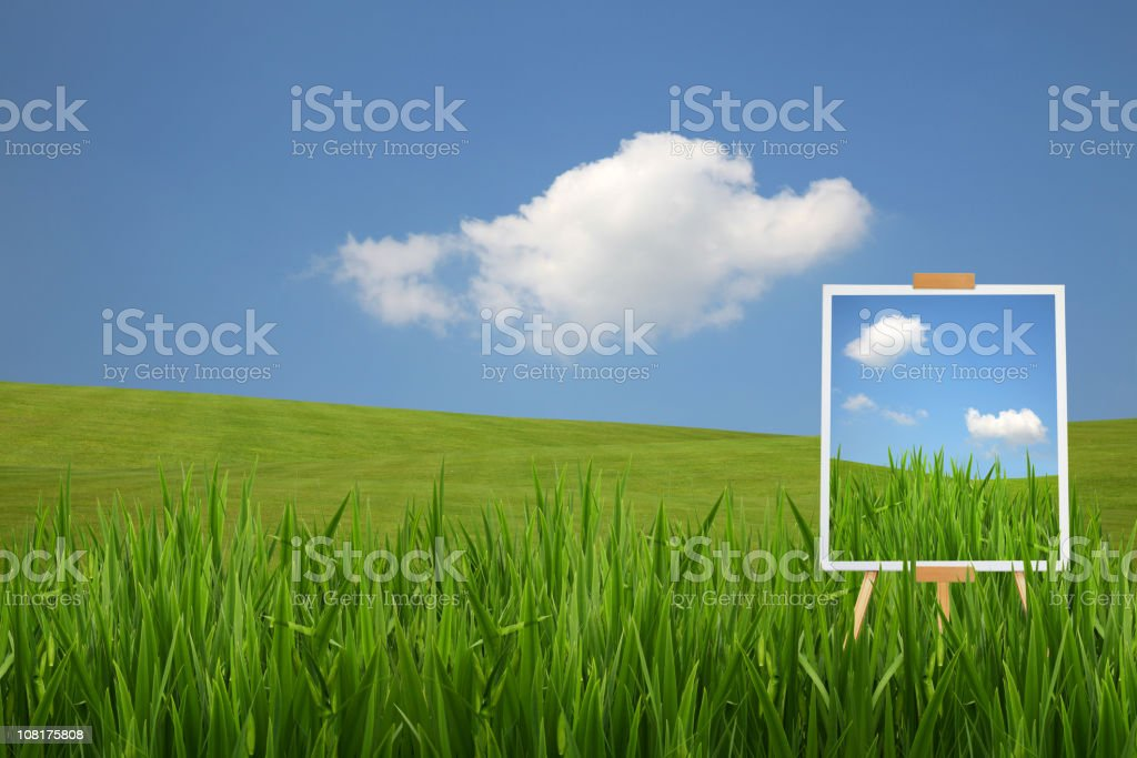 Artists Easel View Painting Green Field and Blue Sky royalty-free stock photo