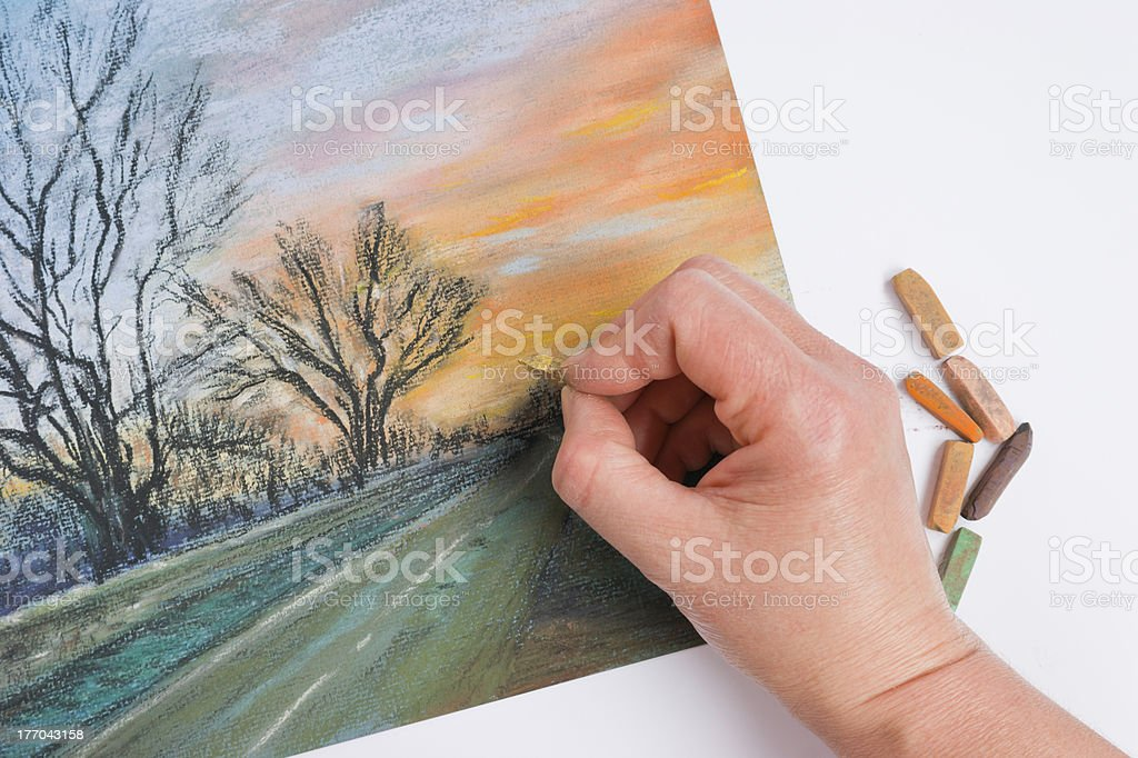Artist's hand pastel landscape stock photo