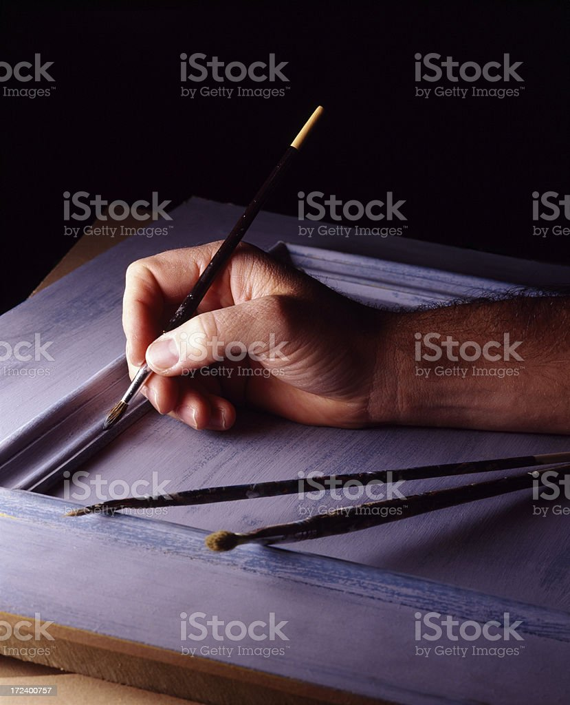 Artists hand with brushes stock photo