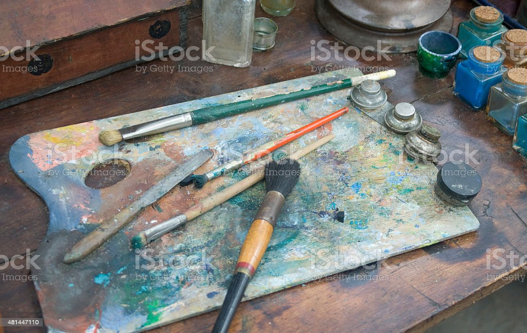 Artists Palette With Paint,Brushes,Containers stock photo