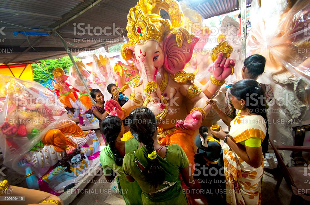 Artists preparing idol for Ganesha Festival in Maharashtra , India. stock photo