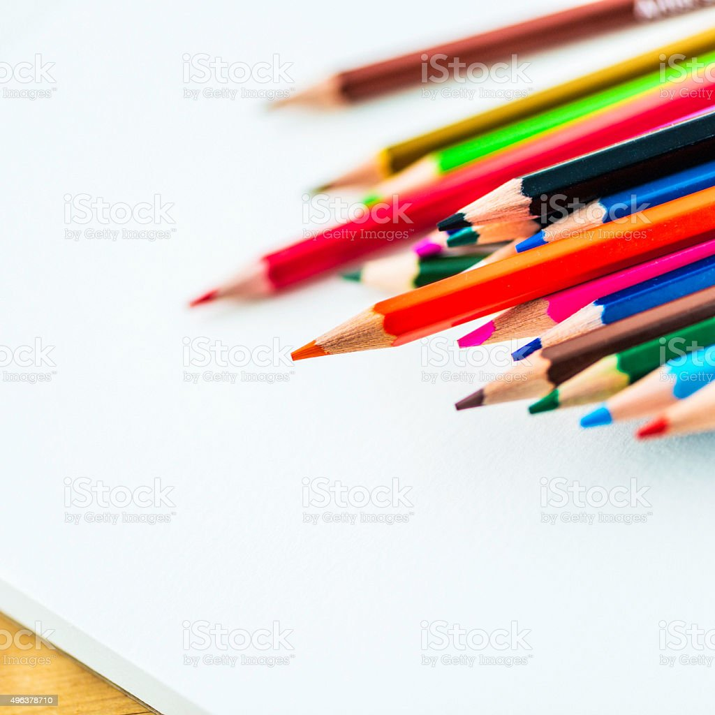 Artist's supplies: Watercolor pencils on blank sketchpad stock photo