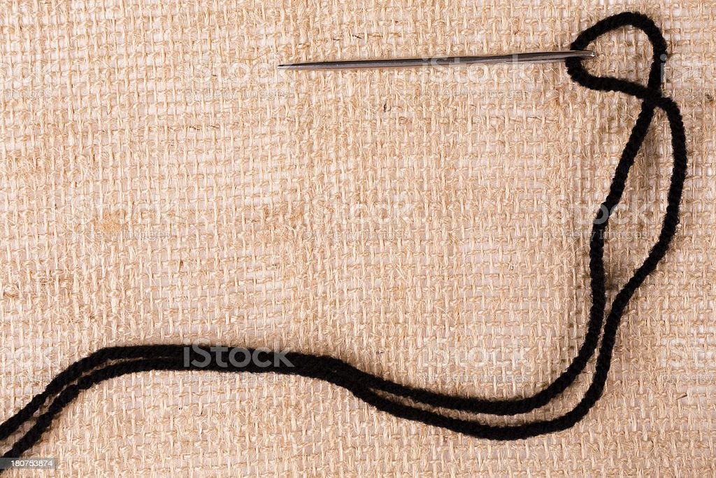 Arts Crafts Background: Needle and Thread stiched into burlap royalty-free stock photo