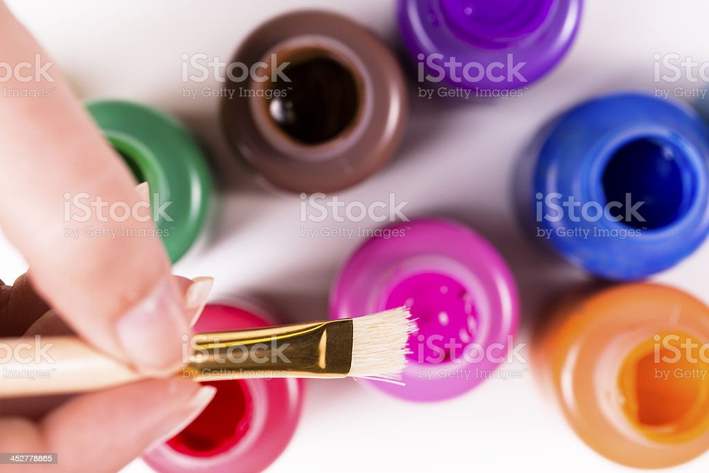 Arts Crafts: Clean paint brush with multiple colors. Creative hobbies royalty-free stock photo