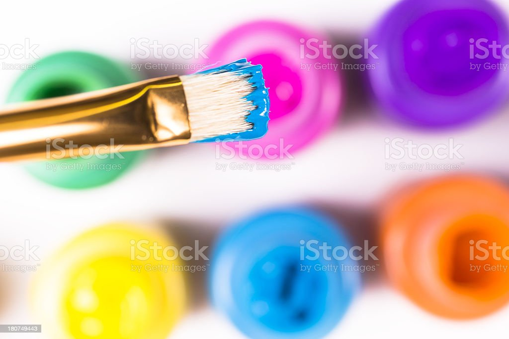 Arts Crafts: Paint brush with blue color. Children, adult hobbies royalty-free stock photo