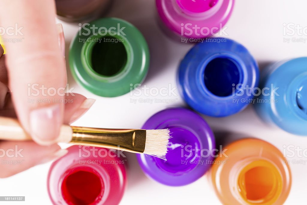 Arts Crafts: Paint brush with purple color. Creative, fun hobbies royalty-free stock photo