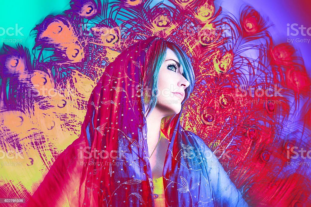 Artsy Creative Woman with Peacock Feathers stock photo
