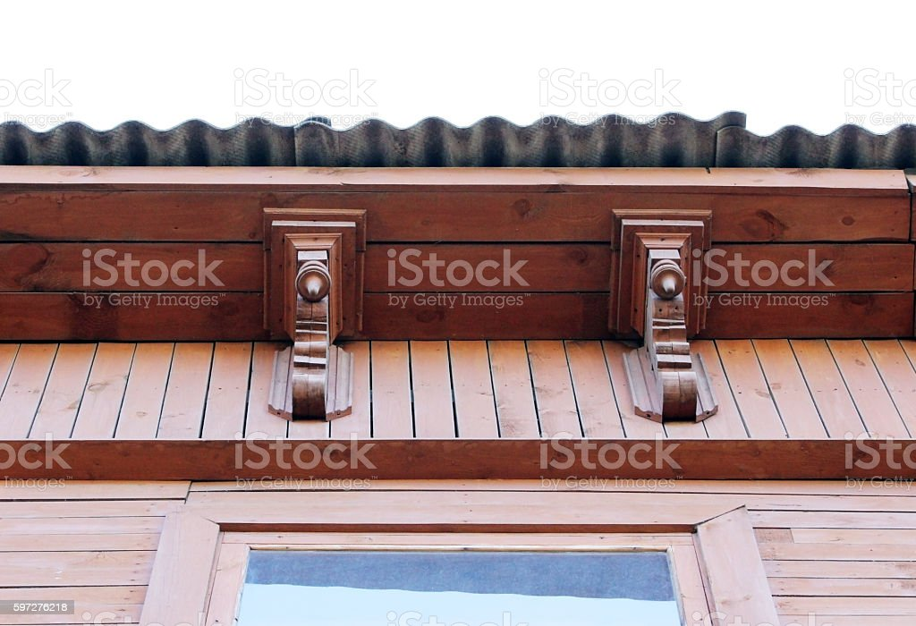 artsy decor trim and classic old wooden house. triangular patterns stock photo