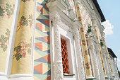 Artsy facade with columns.