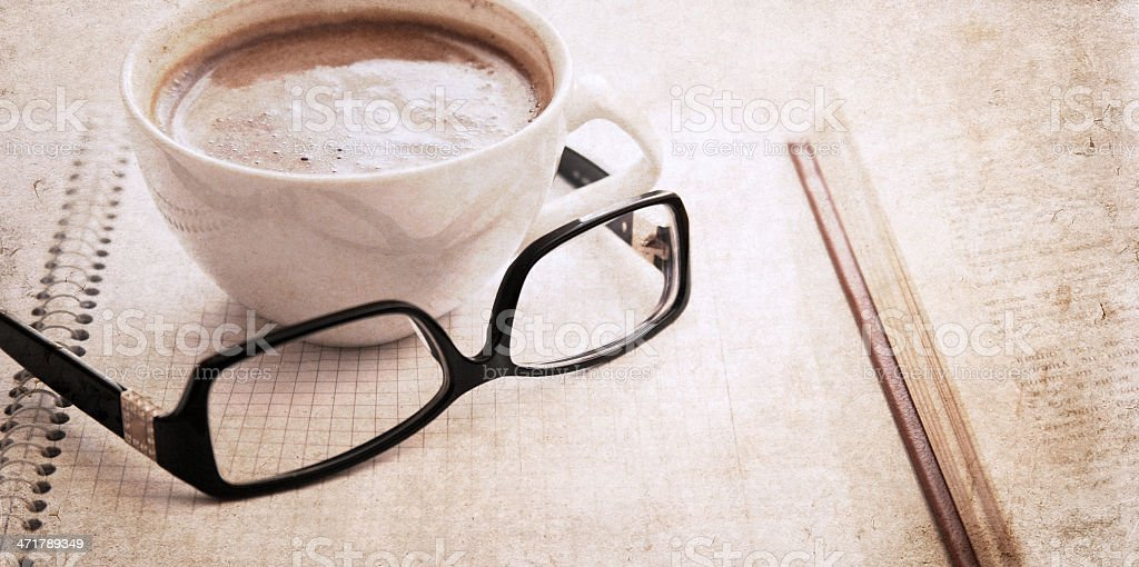 artwork  in vintage  style,  textbook, glasses and cup of coffee royalty-free stock photo
