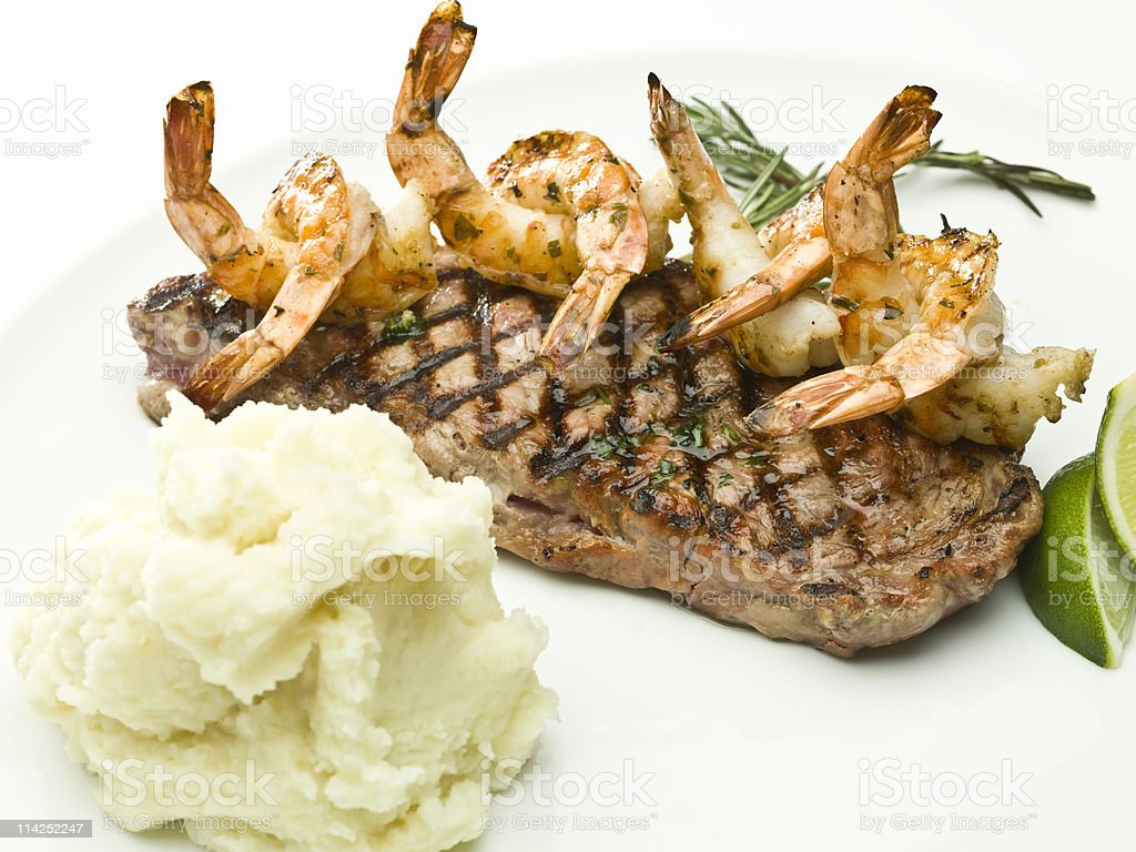 Arty photograph of steak and shrimps played up with mash royalty-free stock photo