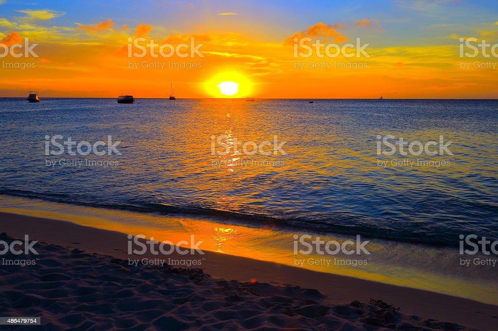 Aruba paradise: turquoise beach ships, dramatic colorful sunset – Caribbean antilles stock photo