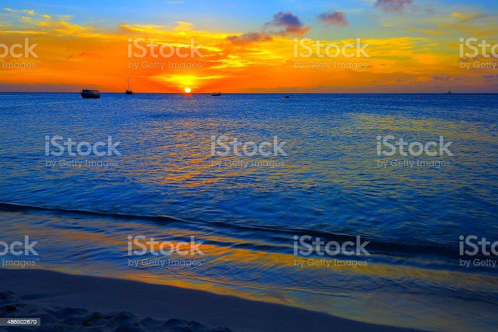 Aruba paradise: turquoise beach, ships, dramatic colorful sunset – Caribbean antilles stock photo