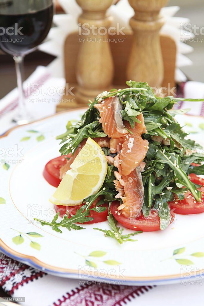 Arugula and salmon salad royalty-free stock photo