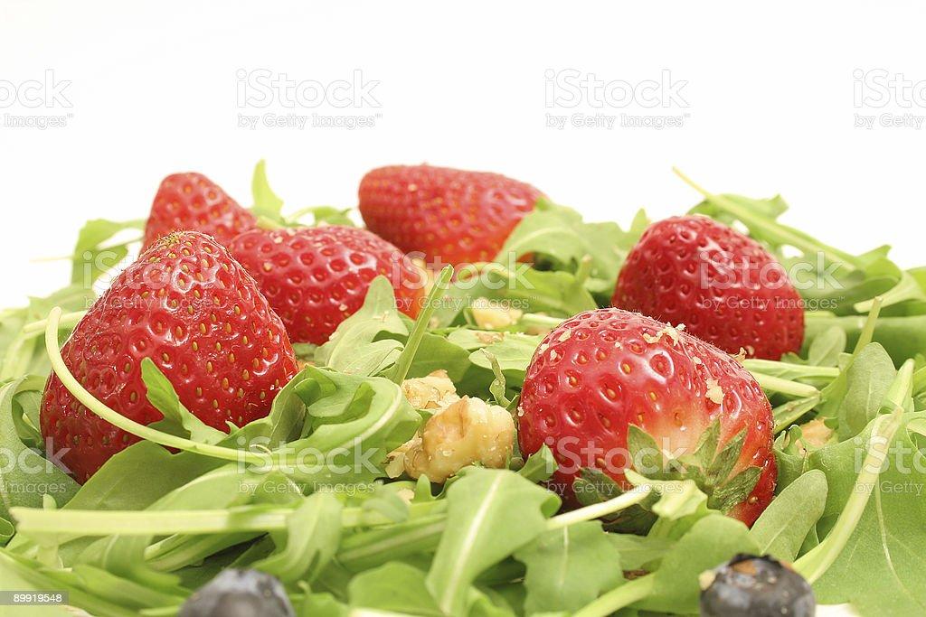 arugula salad w/berries & nuts upclose royalty-free stock photo