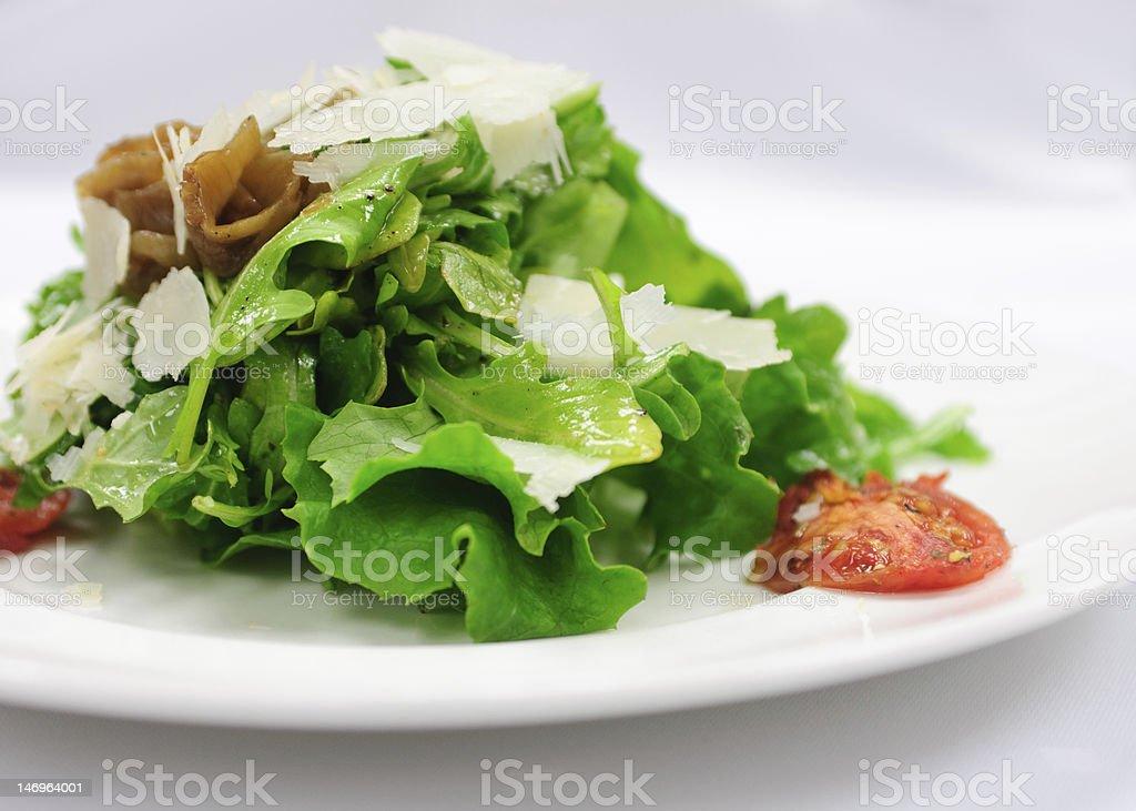 Arugula Salad with caramelized onions and grana padano stock photo