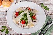 Arugula salad with mushrooms and cheese