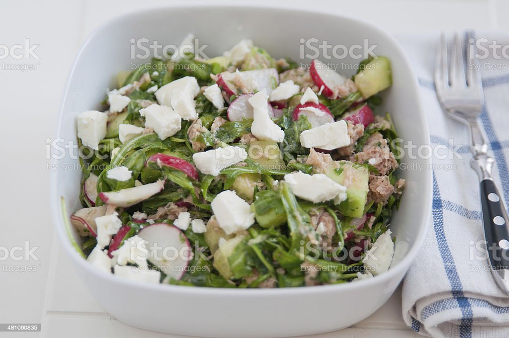 Arugula Salad with tuna and feta cheese stock photo