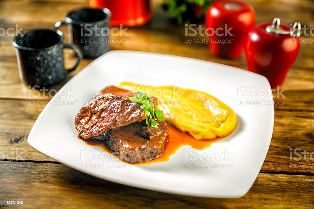 Asado Negro or black barbecue with Smashed Potatoes stock photo
