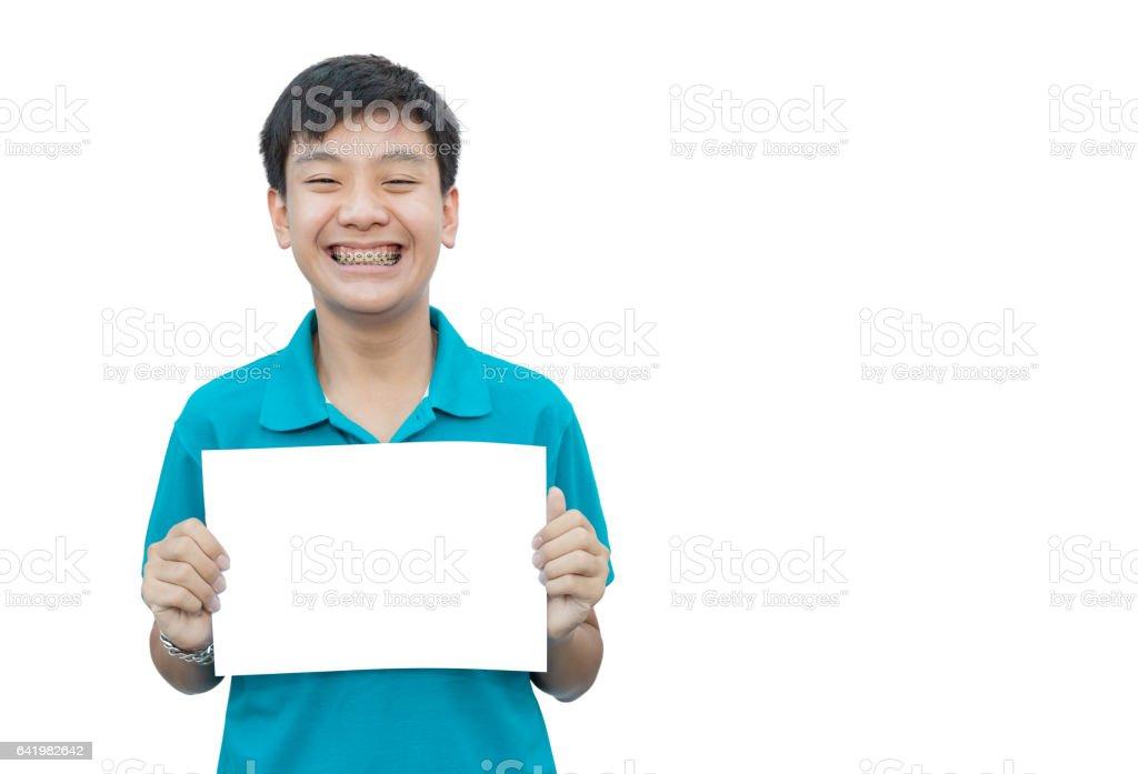 Asain teen beautiful smile teeth brace dental holding blank paper. stock photo