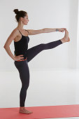 Asana yoga: advanced extended left hand to big toe pose